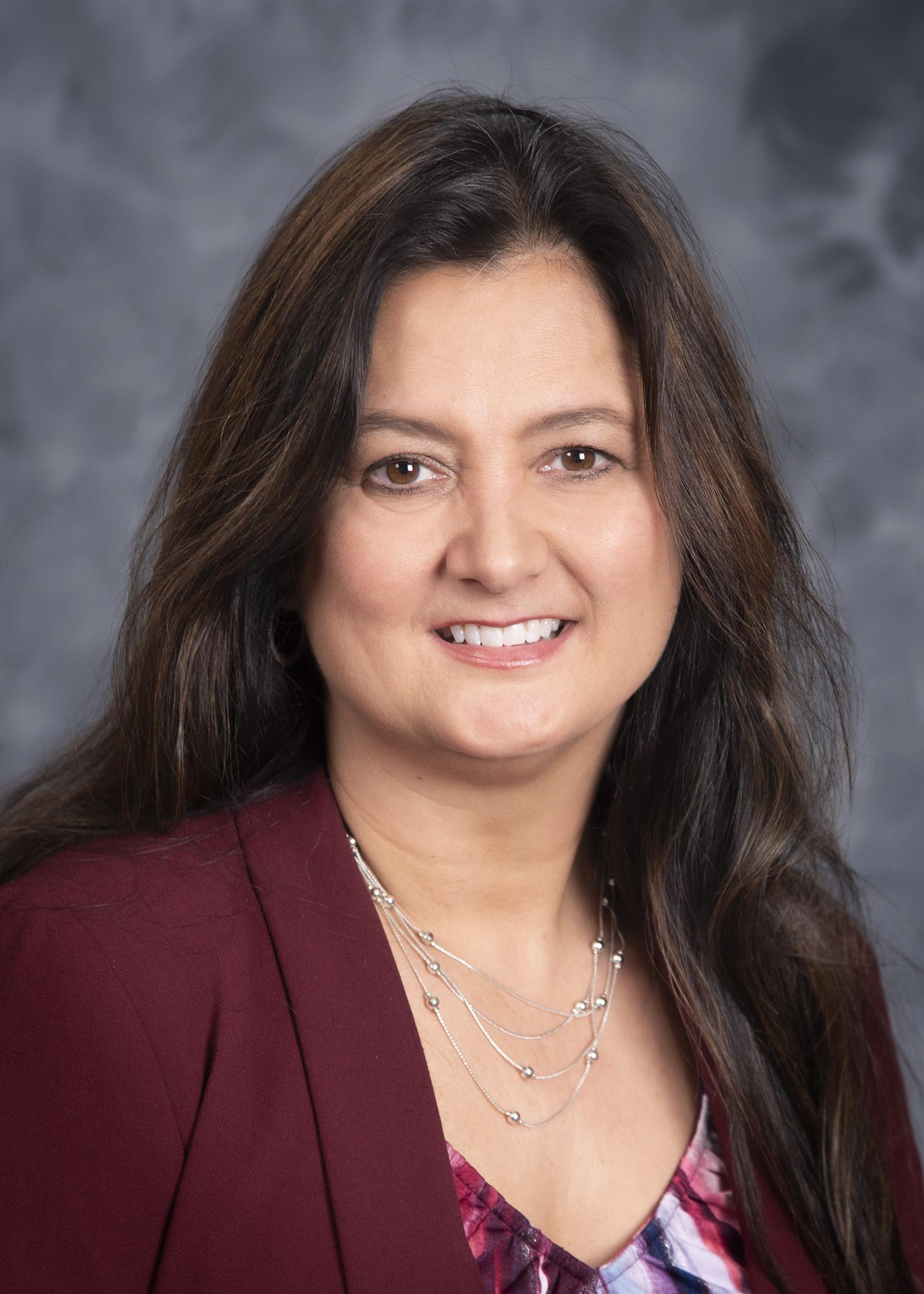 Dr. Carla Huston